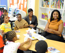 Candice works with her students and school director Tanika Island-Smith.