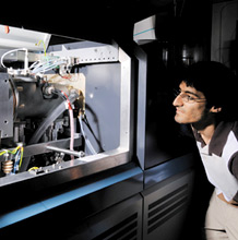 Student watches mass spectrometer